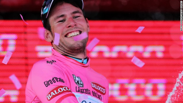 Pretty in pink: Mark Cavendish celebrates his opening stage win in the 2013 Giro d'Italia in Naples.