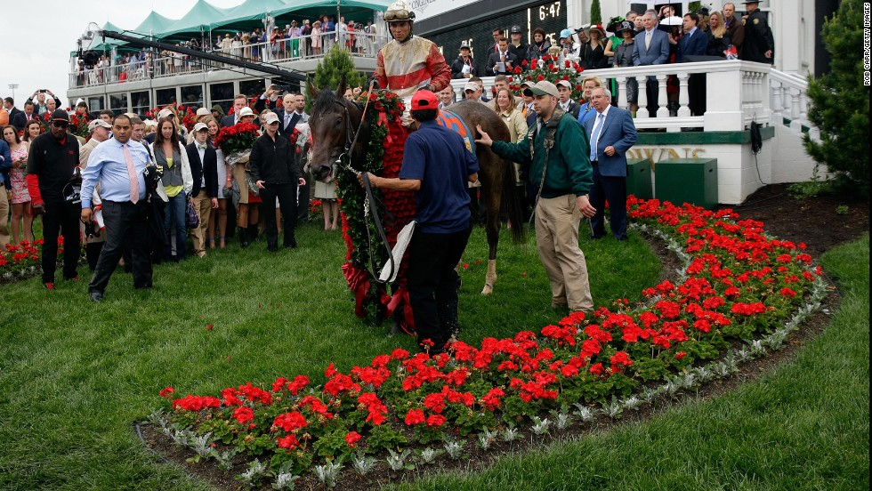 Rosario and Orb stand in the Churchill Downs winner's circle after winning the 139th running of the Kentucky Derby on Saturday, May 4, 2013, in Louisville, Kentucky.