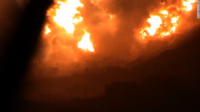 An image taken from a Youtube video purportedly shows an explosion on a mountain filmed from a Damascus suburb Saturday.