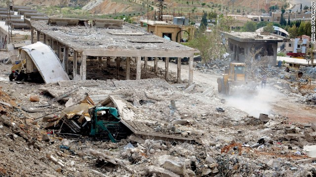 A photo released by the Syrian Arab News Agency shows destruction from what is said was bomb attack in the Al-Hama area of Damascus on Sunday, May 5. According to the Syrian government, Israel launched an attack on a research center in the Damascus suburbs early Sunday.