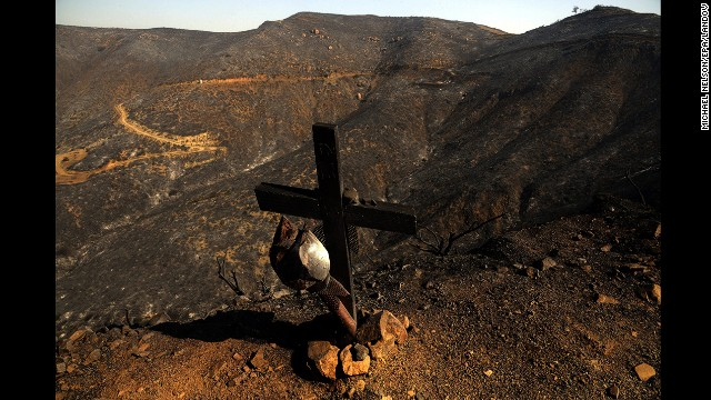 A burned cross stands along the side of a road amid scorched mountains burned by the Springs Fire near Point Mugu State Park, 40 miles north of Los Angeles, on May 4.