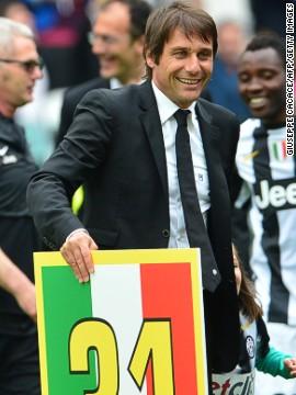 Coach Antonio Conte celebrated after leading his team to a second successive scudetto.