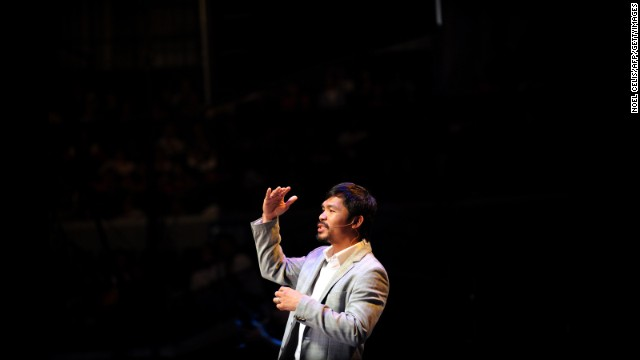 Pacquiao gestures during a prayer rally at the Araneta Coliseum in Manila on July 28, 2012. The prayer rally was a way for Pacquiao to thank his fans and supporters for the blessings he received.