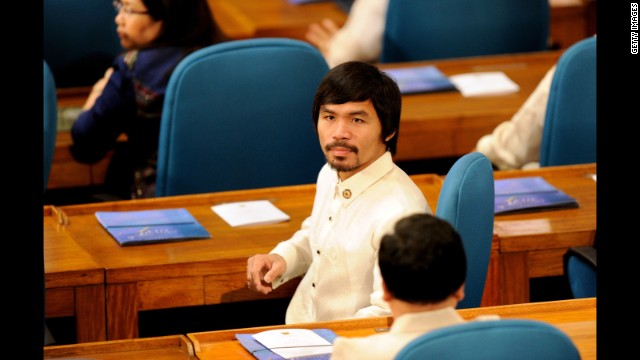 Pacquiao sits with fellow lawmakers during the 15th Congress at the House of Representatives in Quezon City on July 25, 2011.