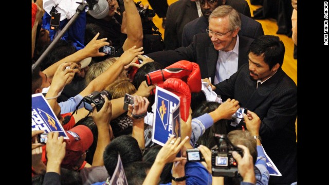 Pacquiao joins Harry Reid, a Nevada senator, on the campaign trail at the Orr Middle School in Las Vegas, Nevada, on October 29, 2010, ahead of the midterm U.S. elections.
