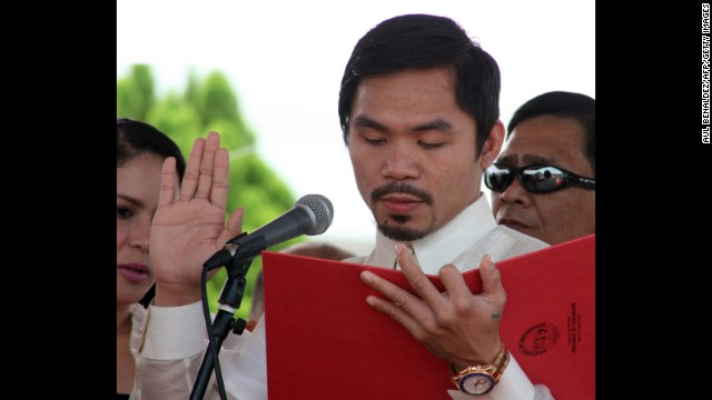 Pacquiao takes his oath of office as congressman at the provincial capitol in Alabel, Sarangani province, on June 28, 2010.