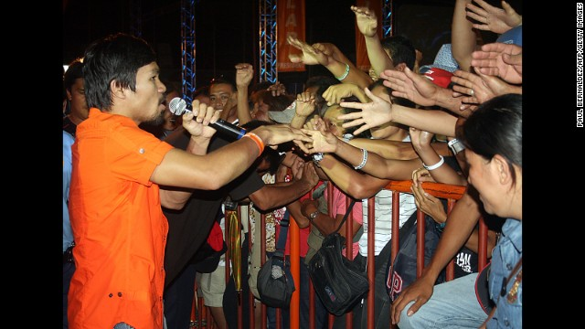 Pacquiao greets supporters during a campaign rally in Kiamba in April 2010.