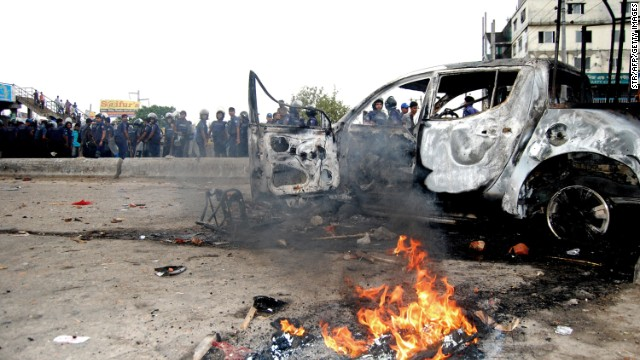 Bangladeshi police gather near a car set ablaze by Islamist protesters during clashes on Monday, May 6. Police broke up a protest of tens of thousands of religious hardliners and shut down an Islamist television station Monday after battles in the streets of Dhaka. &lt;a href='http://www.cnn.com/2013/05/05/world/asia/bangladesh-clashes/index.html'&gt;Demonstrations calling for religious laws&lt;/a&gt;, led by the ultraconservative group Hefazat-e-Islam (Protectors of Islam), have been building since February.