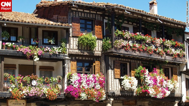 Flowers spill from the window boxes of ancient buildings in La Alberca, about an hour from Salamanca in western Spain.