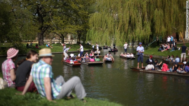 People soak up the spring sunshine on the River Cam on Monday, May 6, in Cambridge, England.
