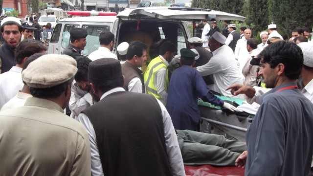 Victims arrive at a hospital after a bomb exploded on Monday during an election campaign meeting in the Kurram tribal district.