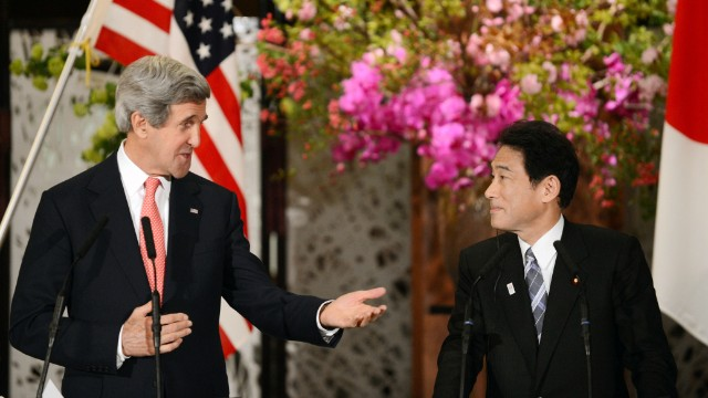 Kerry gestures to Japanese Foreign Minister Fumio Kishida (R) during their joint press conference in Tokyo on April 14, 2013. Kerry traveled to Asia to discuss nuclear tensions on the Korean peninsula and secured vital support from China to help defuse the weeks-long crisis.
