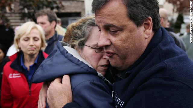 Christie tries to comfort Alice Cimillo, whose home was damaged by Superstorm Sandy, on November 1, 2012, in Moonachie, New Jersey.