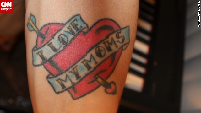 "Kyle Divine honors both his moms with a tattoo he got on his arm on Mother's Day in 2006. ""My moms were the best role models I had while I was growing up, regardless of sexual orientation,"" he said. ""I got the tattoo to show them and the world that I am proud to have them as my parents."" It also has a more subtle meaning: ""Without actually saying it, the tattoo says that I am a supporter of gay rights."" Divine says both his moms love the ink."
