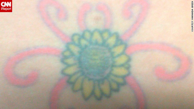 "Maranda Green's mother passed away from complications of polycystic kidney disease when she was just 14. At 19, Green was diagnosed with the same condition. The meaning of her sunflower tattoo is twofold: It's in memory of her mom, and it's a symbol of her own resolve in fighting the disease. Why a sunflower? ""My mom always loved those big, seemingly flowing fields of sunflowers,"" said Green. The tattoo is, of course, on her lower back -- over the kidneys."