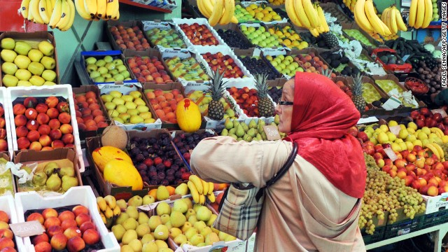 A customer waits to be served at a fruit market in Rabat on June 24.