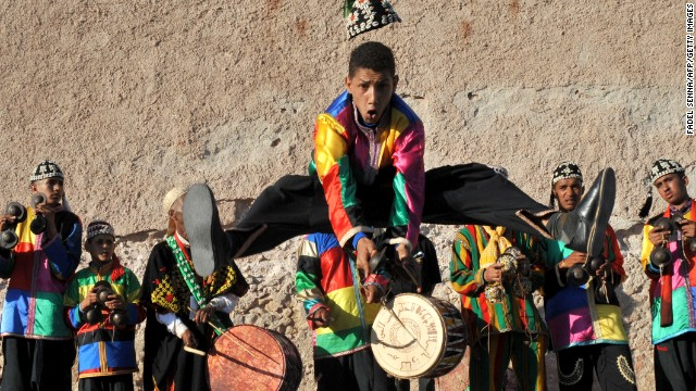 Members of a Gnaoua troupe parade along a street in Essaouira on June 21 ahead of the start of the annual Gnaoua World Music Festival.