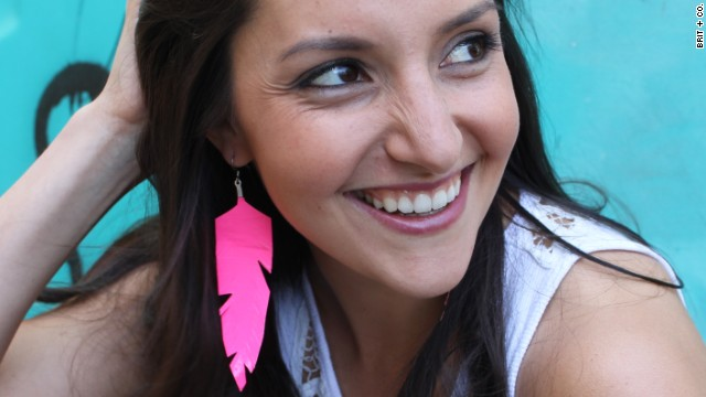 Morin models <a href='http://www.brit.co/flirty-fluorescent-feathers-another-win-for-duct-tape/' target='_blank'>fluorescent feather earrings</a> made with neon duct tape.