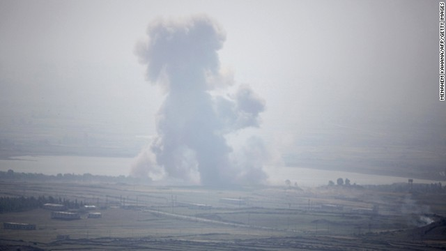 Smoke rises from an explosion in a Syrian village near the Israeli border on Tuesday, May 7.