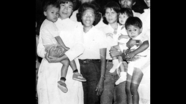 Oebanda's first day outside prison, with her children on February 26, 1986. She was captured while fighting for rebel forces against the dictatorship of President Ferdinand Marcos.