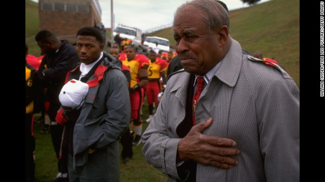 Eddie Robinson served as Grambling State University's head football coach for 57 seasons from 1941 to 1997. Robinson -- here listening to the national anthem before his final game -- coached more than 4,000 players.