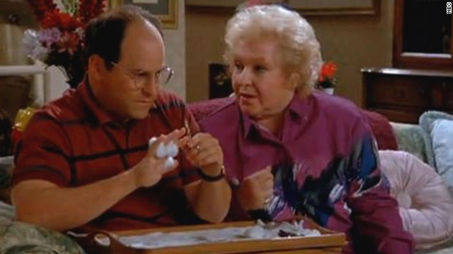 "George Costanza's mom on ""Seinfeld,"" Estelle Costanza, wasn't a part of the main cast, but she was always a welcome addition to an episode. Played by Estelle Harris, seen here with Jason Alexander as George, ""Seinfeld"" fans know that she only yells to show she cares."