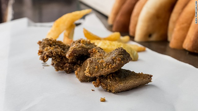 The Moroccan version of a wienerschnitzel: smooth and buttery calves' livers, crumbed and fried. Food in souks is sold by weight. The vendor will chop up your meat and serve it in a sandwich or with a handful of fries.