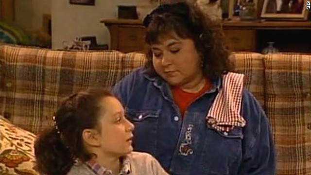 Roseanne was the outspoken and straight-shooting leader of the Connor family on the sitcom that bears her name. She could be crass as she tended to her kids D.J., Becky and Darlene (portrayed by Sara Gilbert, seen here), but that was also a big part of her charm.