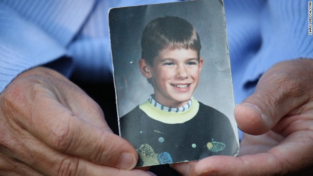 Patty Wetterling holds a photo of her son Jacob, who was abducted at age 11, more than 23 years ago.