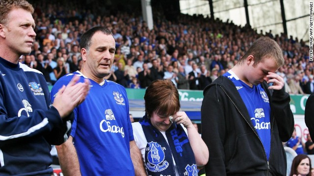 The family of murdered 11-year old boy Rhys Jones stand next to Moyes during a minute's appreciation before the start of the Premier League match between Everton and Blackburn Rovers at Goodison Park in August 2007. Rhys died after being shot in the neck as he played football with friends outside the Fir Tree pub in Croxteth, Liverpool in August.