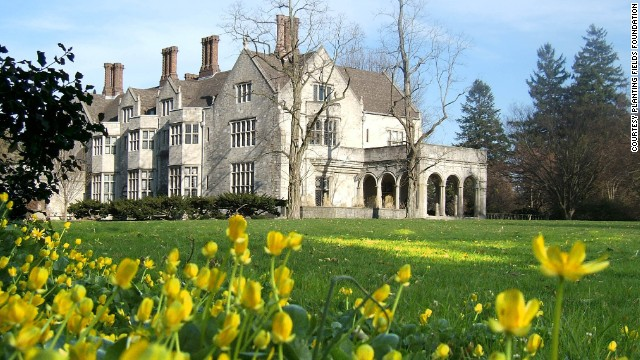 <a href='http://www.plantingfields.org' target='_blank'>Coe Hall</a>, a 65-room Elizabethan-style mansion, was built from 1918-1921 by Walker & Gilette for William Robertson Coe. Coe was a marine insurance executive and his wife, Mai Coe, was the daughter of Henry Huttleston Rogers, one of the founders of Standard Oil. The house, furnished with antiques and artwork, is open for self-guided tours.