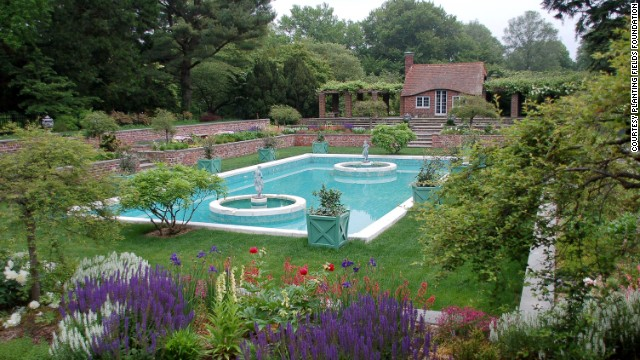 The estate is part of Planting Fields Arboretum State Historic Park, which hosts special exhibitions in a smaller home on the grounds. The arboretum covers 409 acres of lawn, woodlands and formal gardens, including this Italian garden restored in 2010.