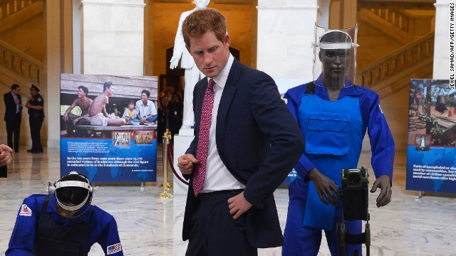 Harry tours an exhibit in the rotunda of the Russell Senate Office Building on finding and clearing landmines.
