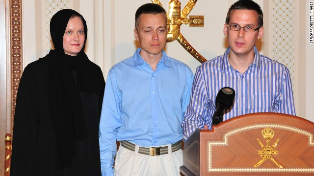 An Austrian student (R) and a Finnish couple abducted in Yemen by Al-Qaeda militants talk to local media on Thursday in Oman.
