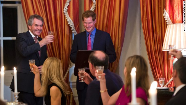 British Ambassador Sir Peter Westmacott toasts Prince Harry at a dinner in Washington on May 9.