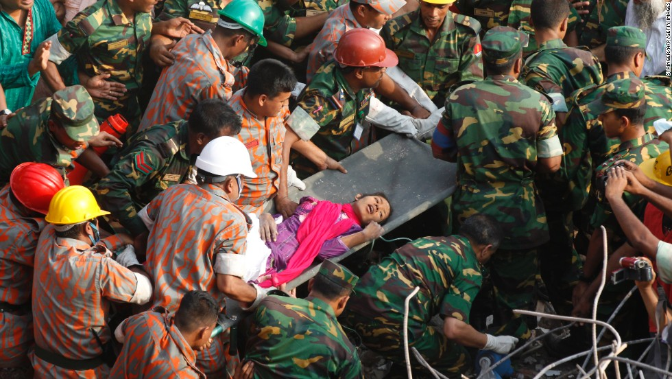 Rescue workers carry <a href='http://www.cnn.com/2013/05/13/world/asia/bangladesh-building-collapse/index.html'>Reshma Begum</a>, 19, to safety on Friday, May 10, a day after her discovery alive amid the wreckage of a building that had entombed her since it collapsed on April 24, in Dhaka, Bangladesh. At least 1,127 people have been confirmed dead from the <a href='http://www.cnn.com/2013/05/12/world/asia/bangladesh-building-collapse/index.html'>garment factory building collapse</a>.
