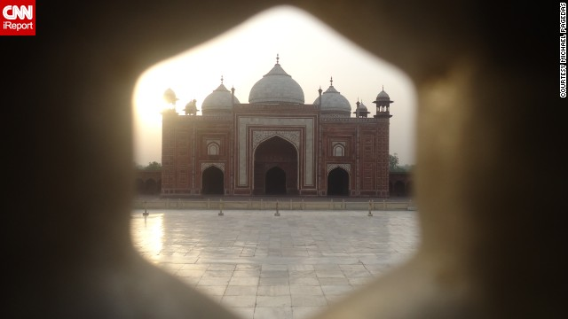 While visiting the Taj Mahal in Agra, India, Michael Pagedas noticed a unique view of a mosque situated next to the iconic mausoleum. He photographed the mosque through the Taj Mahal's craved marble screen. 