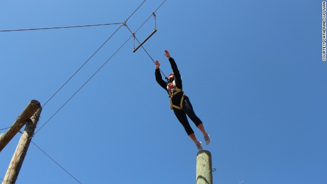 "Campers participate in the ""leap of faith,"" springing from a 35-foot pole onto a trapeze."