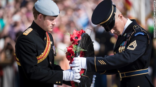 Prince Harry participates in a wreath-laying ceremony at the Tomb of the Unknowns in Arlington National Cemetery on Friday, May 10. Washington was the first stop on his <a href='http://www.cnn.com/2013/05/08/world/europe/prince-harry-united-states/index.html'>weeklong trip to the United States</a>.