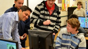 Nihar Shah, left in striped shirt, teaches a computer-science course at Liberty High School in Issaquah, Washington.