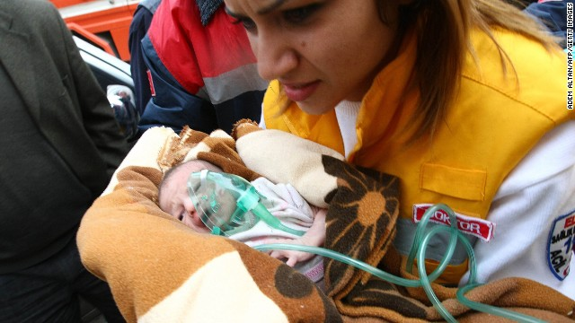 A baby, her mother and her grandmother are rescued in eastern Turkey on October 25, 2011, two days after a 7.2-magnitude earthquake killed more than 600 people. Dramatic video showed 2-week-old Arza Karaduman being carried from the debris of a multiple-story building.