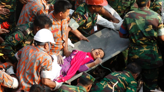 Seventeen days after a building collapsed in Savar, Bangladesh, rescuers pull Reshma Begum from the rubble on May 10. More than 1,000 people have died since the nine-story garment factory building fell on April 24.