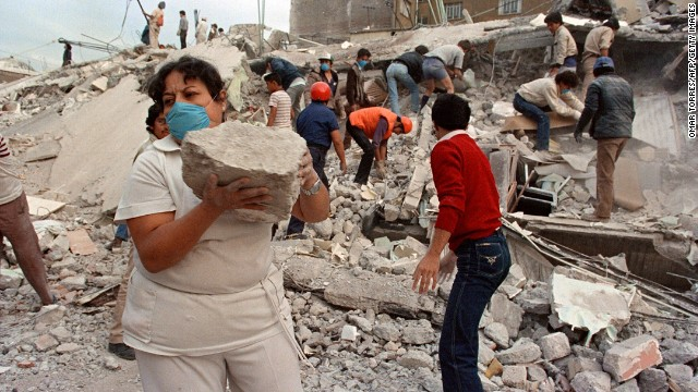 "Three infants are pulled alive from the crumbled Benito Juarez Hospital seven days after a powerful earthquake hit the Mexican capital on September 19, 1985. With more than 10,000 people killed, the newborns became known as the ""miracle babies"" of Mexico City."