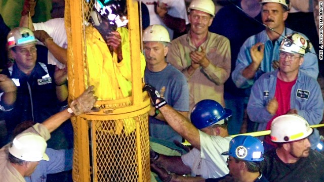 After being trapped for more than three days, nine miners are rescued from the Quecreek coal mine in Somerset, Pennsylvania, on July 28, 2002. They were caught in a 4-foot-high chamber 240 feet underground after breaching a wall separating their mine from an older, flooded shaft on July 24.