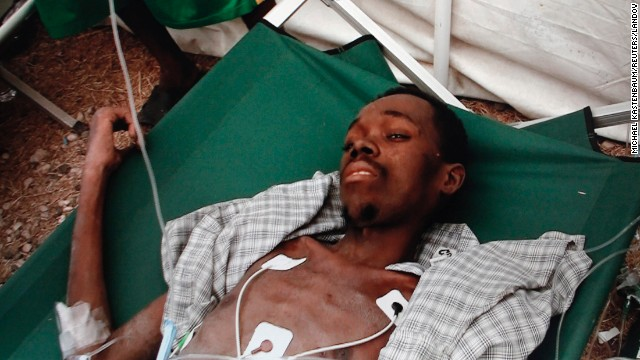 A man identified as Evan Muncie, 28, is found in the ruins of a marketplace, his family tells CNN, nearly a month after a 7.0-magnitude earthquake devastated Haiti on January 12, 2010. He suffered from extreme dehydration and malnutrition, but did not appear to have significant crushing injuries, doctors said.