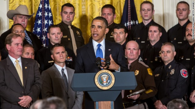 Honoring cops, Obama keeps pressure on gun control