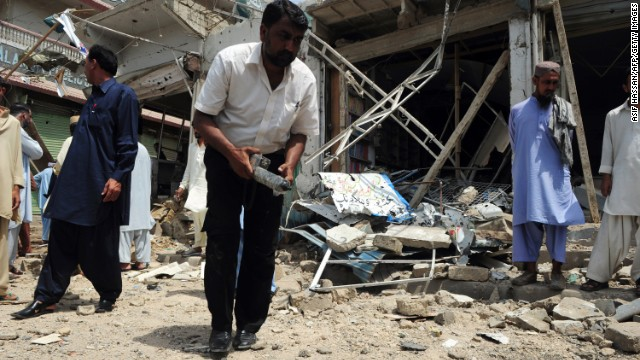 A bomb disposal expert examines the site of a detonation in Karachi, Pakistan on May 11.