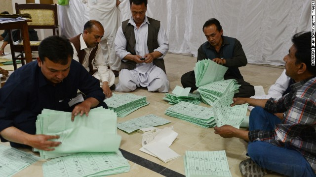 Election officials count ballot papers at the end of polling in Quetta, Pakistan on May 11.