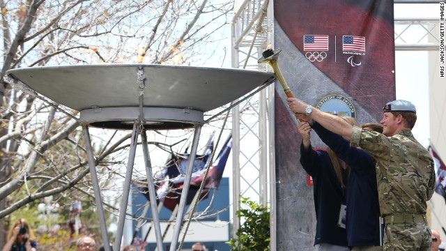 Prince Harry helps to light the cauldron as he attends the opening ceremony of the Warrior Games in Colorado Springs, Colorado, on Saturday, May 11, during the third day of his visit.