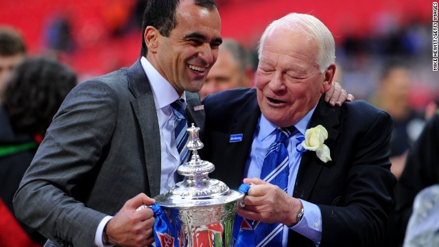 Wigan manager Roberto Martinez, left, celebrates with his chairman Dave Whelan after winning the FA Cup.